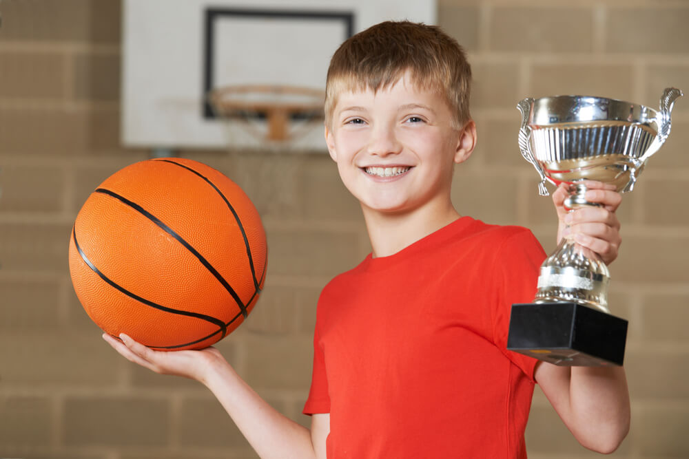 preteen winning basketball tournament