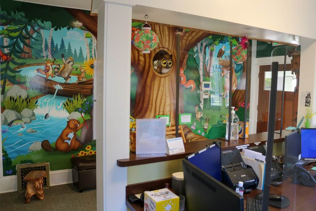 Interior of Silverton office with front desk and mural