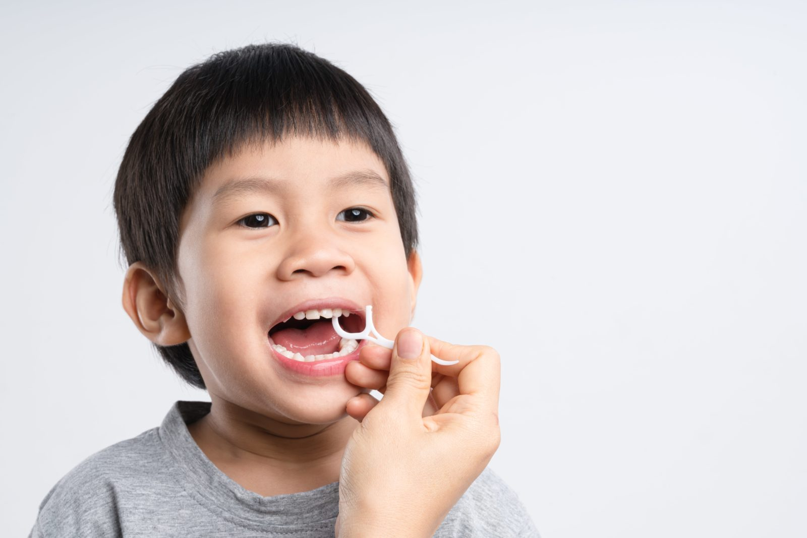 helping child floss